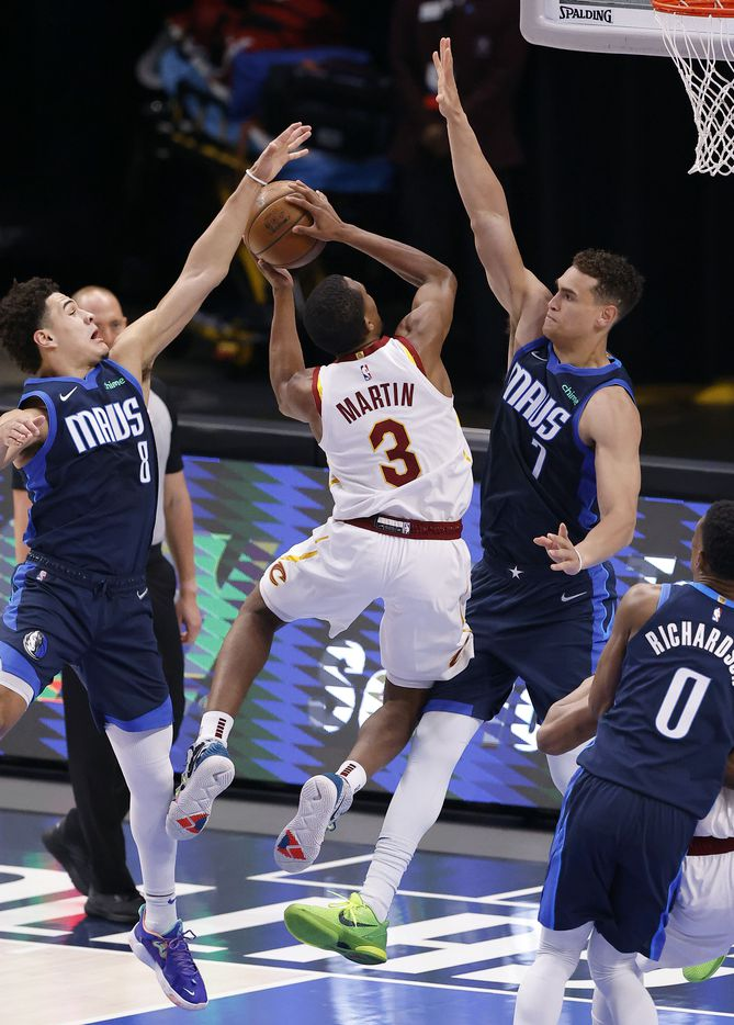 Dallas Mavericks guard Josh Green (8) blocks a shot by Cleveland Cavaliers guard Jeremiah Martin (3) in the second quarter at the American Airlines Center in Dallas, Friday, May 7, 2021. Dallas Mavericks center Dwight Powell (7) joins in on the defense. (Tom Fox/The Dallas Morning News)