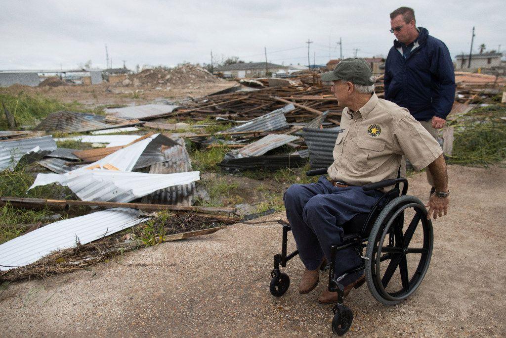 Texas Gov. Greg Abbott surveyed damage on Pearl Street in Rockport on Monday following Hurricane Harvey.