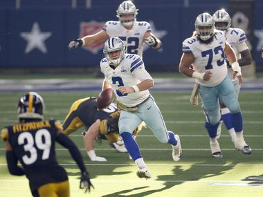 Cowboys quarterback Garrett Gilbert (3) runs for a first down against the Steelers during the second quarter of play at AT&T Stadium in Arlington on Sunday, Nov. 8, 2020.