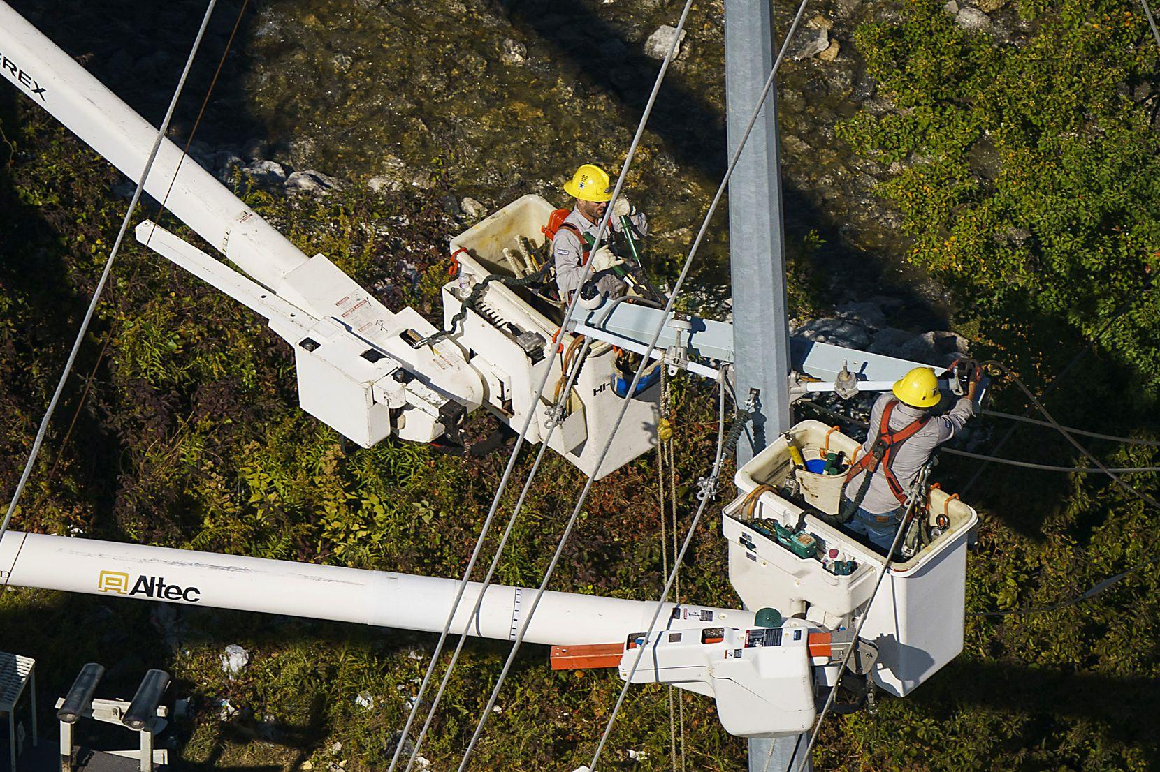 Crews work on power restoration from tornado damage on Monday, Oct. 21, 2019, in Garland.