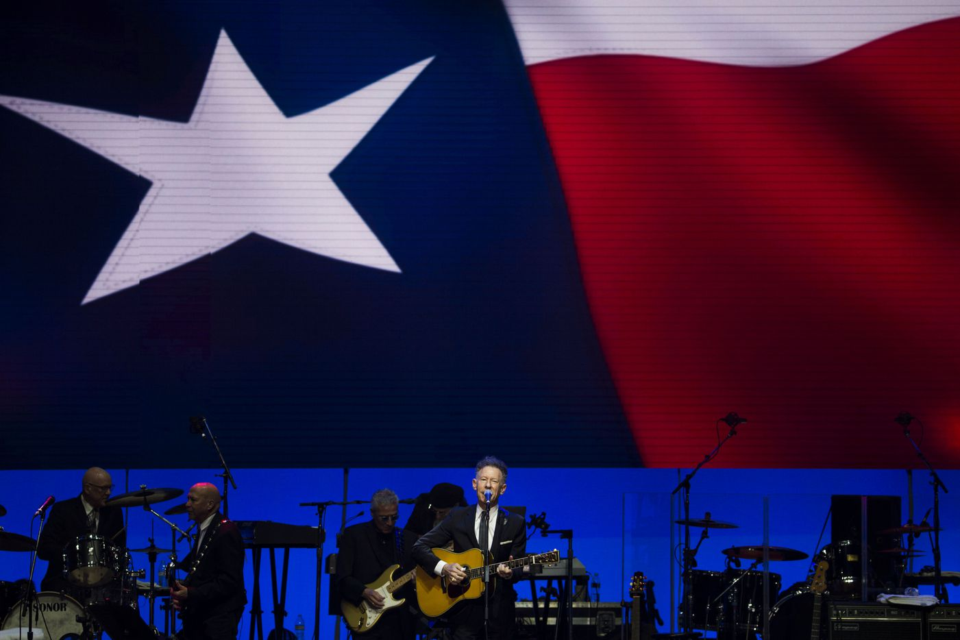 Lyle Lovett performs during Deep from the Heart: The One America Appeal Concert.