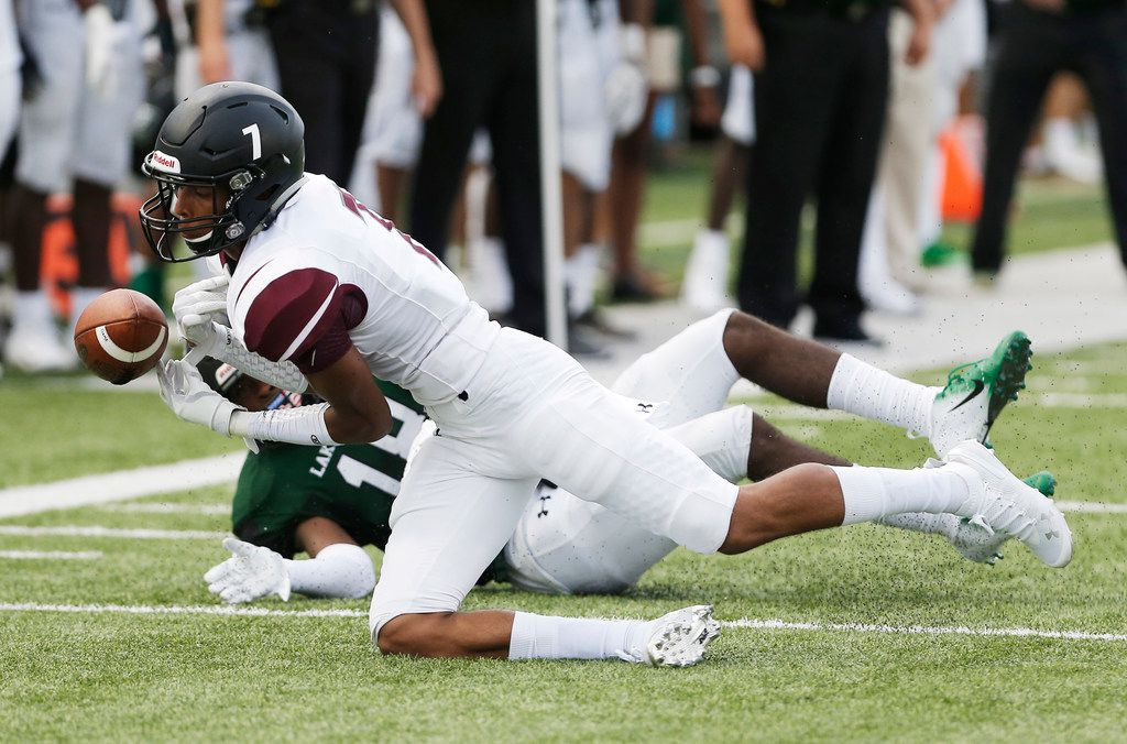 Mansfield Timberview junior defensive back Jalen Kimber (7) nearly intercepts a pass intended for Mansfield Lake Ridge junior wide receiver Keylan Johnson (18) during the first half of a high school football game at R.L. Anderson Stadium in Mansfield, Friday, September 14, 2018. (Brandon Wade/Special Contributor)