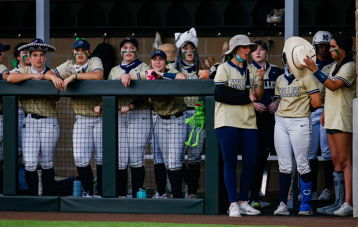 Keller players wear random hats on the sideline of a nondistrict softball game against Denton Guyer in Denton on Tuesday, March 30, 2021. (Juan Figueroa/ The Dallas Morning News)