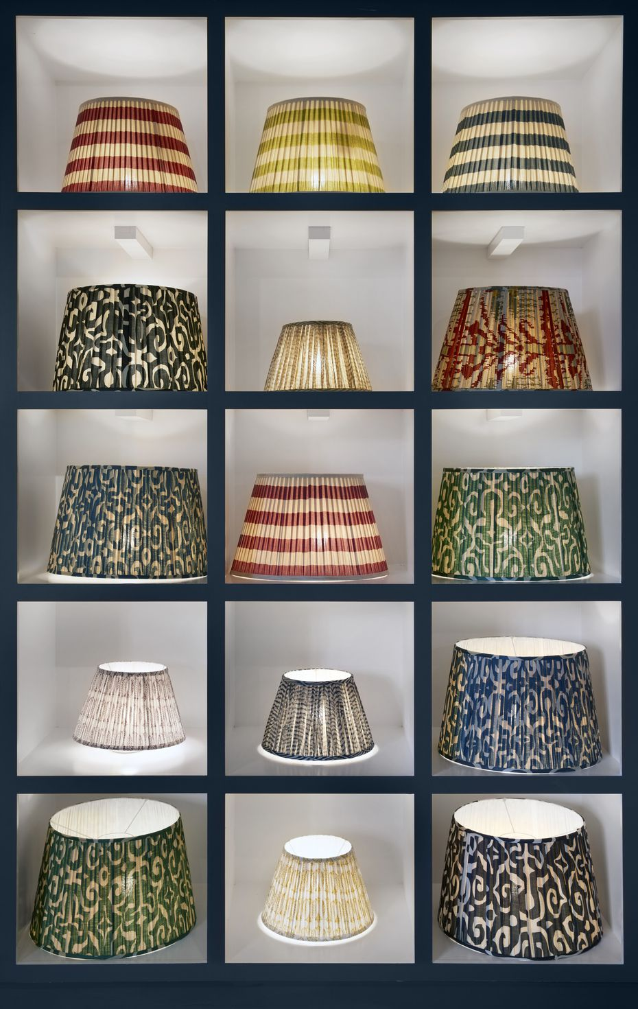 Mix and match lamp shades at OKA, which promotes color and patterns in its home furnishings designs.