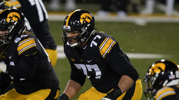 Iowa offensive lineman Alaric Jackson (77) looks to make a block during the second half of an NCAA college football game against Wisconsin, Saturday, Dec. 12, 2020, in Iowa City, Iowa. Iowa won 28-7.