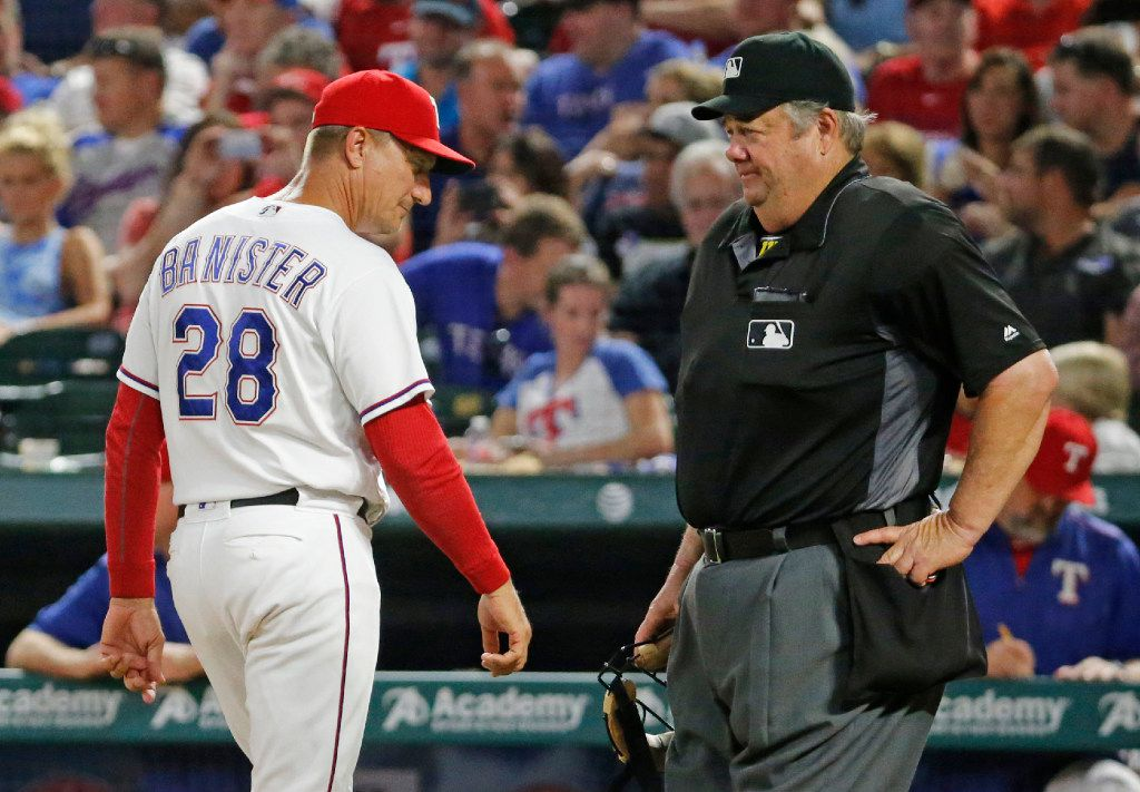 Texas Rangers manager Jeff Banister (28) walks past home plate umpire Joe West during the Los Angeles Angels vs. the Texas Rangers major league baseball game at Globe Life Park in Arlington on Wednesday, September 21, 2016. (Louis DeLuca/The Dallas Morning News)
