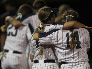 Flower Mound players console one another following their 2-0 loss to Deer Park. The two teams played their UIL 6A state softball semifinal game at Leander Glenn High School in Leander on June 4, 2021. (Steve Hamm/ Special Contributor)