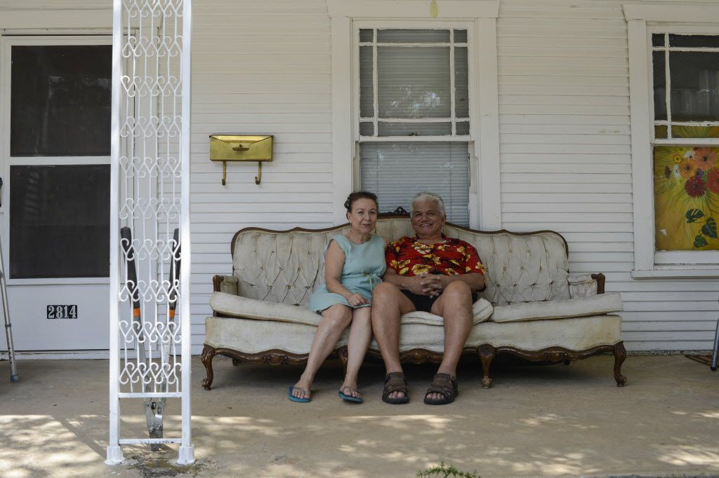 Johnny Rincon and his wife, Sarah, sit on the porch of their rented home on Harry Hines Boulevard, in the Dallas neighborhood formerly known as Little Mexico on Sept. 5, 2014. Johnny Rincon grew up in the neighborhood and is one of the last remaining original residents. (Jim Tuttle/The Dallas Morning News)