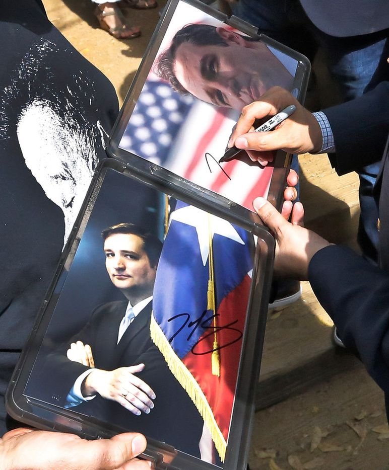 Sen. Ted Cruz signs autographs as he works the crowd while campaigning at the Katy Trail Ice House Outpost in Plano on Oct. 4, 2018. (Louis DeLuca/The Dallas Morning News)