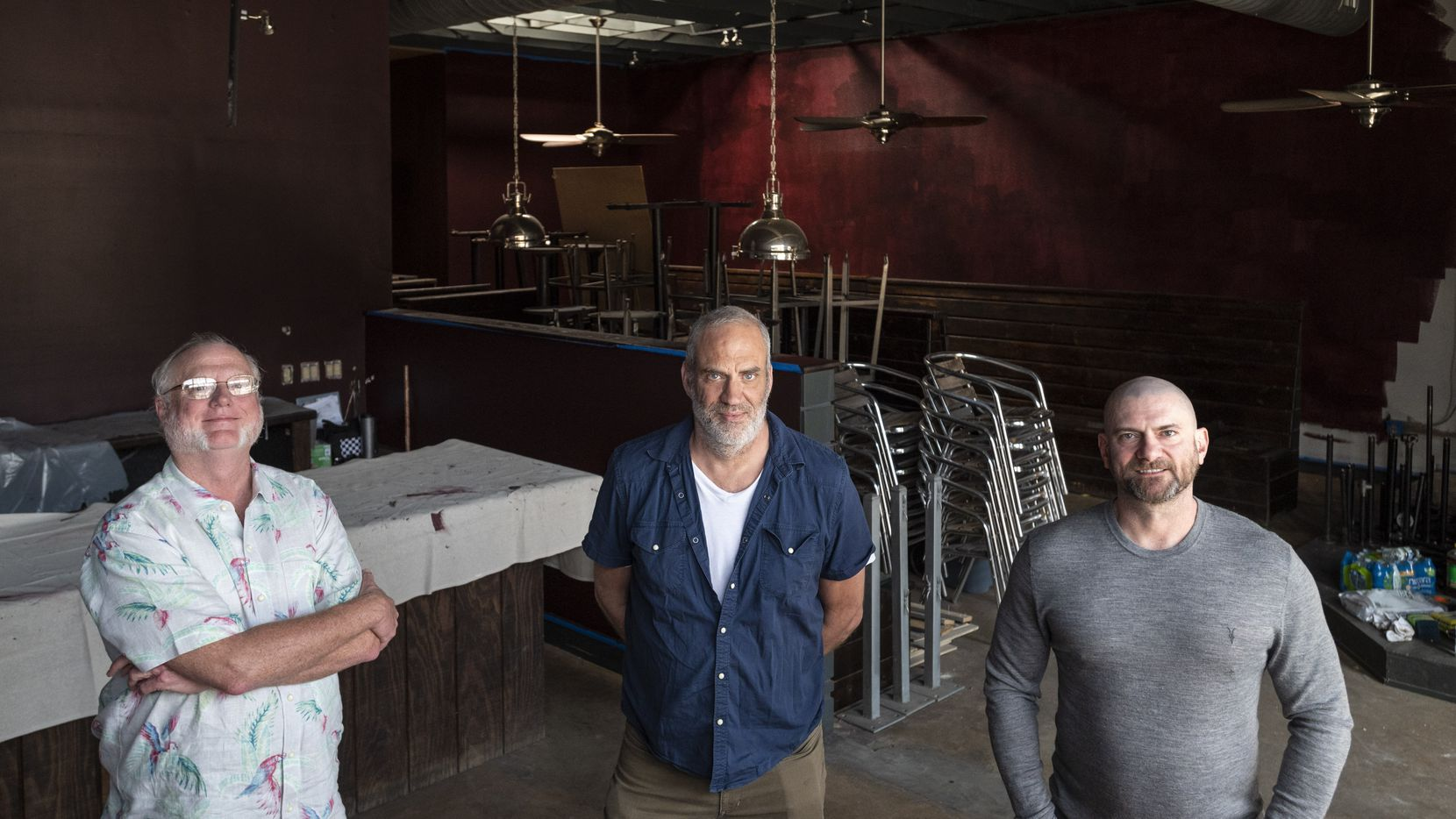 L-R: Cheapsteaks owners Ed Laster, John Jay Meyers and Jeff Biehler inside the old Stonedeck Pizza Pub where their new restaurant Cheap Steaks will eventually open, on Wednesday, March 24, 2021 in Dallas. Cheap Steaks will cater to steak fans and music lovers as they will have an indoor and outdoor stage at their restaurant-venue.