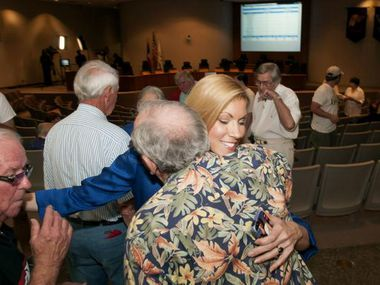 Irving Mayor Beth Van Duyne (center) was met with hugs from supporters at City Hall on Saturday after her victory over Herbert Gears.