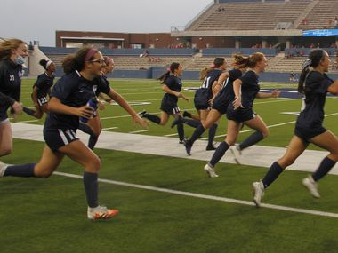 Flower Mound players bolt onto the field at the sound of the buzzer as they defeated Flower Mound Marcus 3-0 to advance. The two teams played their Class 6A Region 1 final girls soccer playoff game at McKinney ISD Stadium in McKinney on April 9, 2021. (Steve Hamm/ Special Contributor)