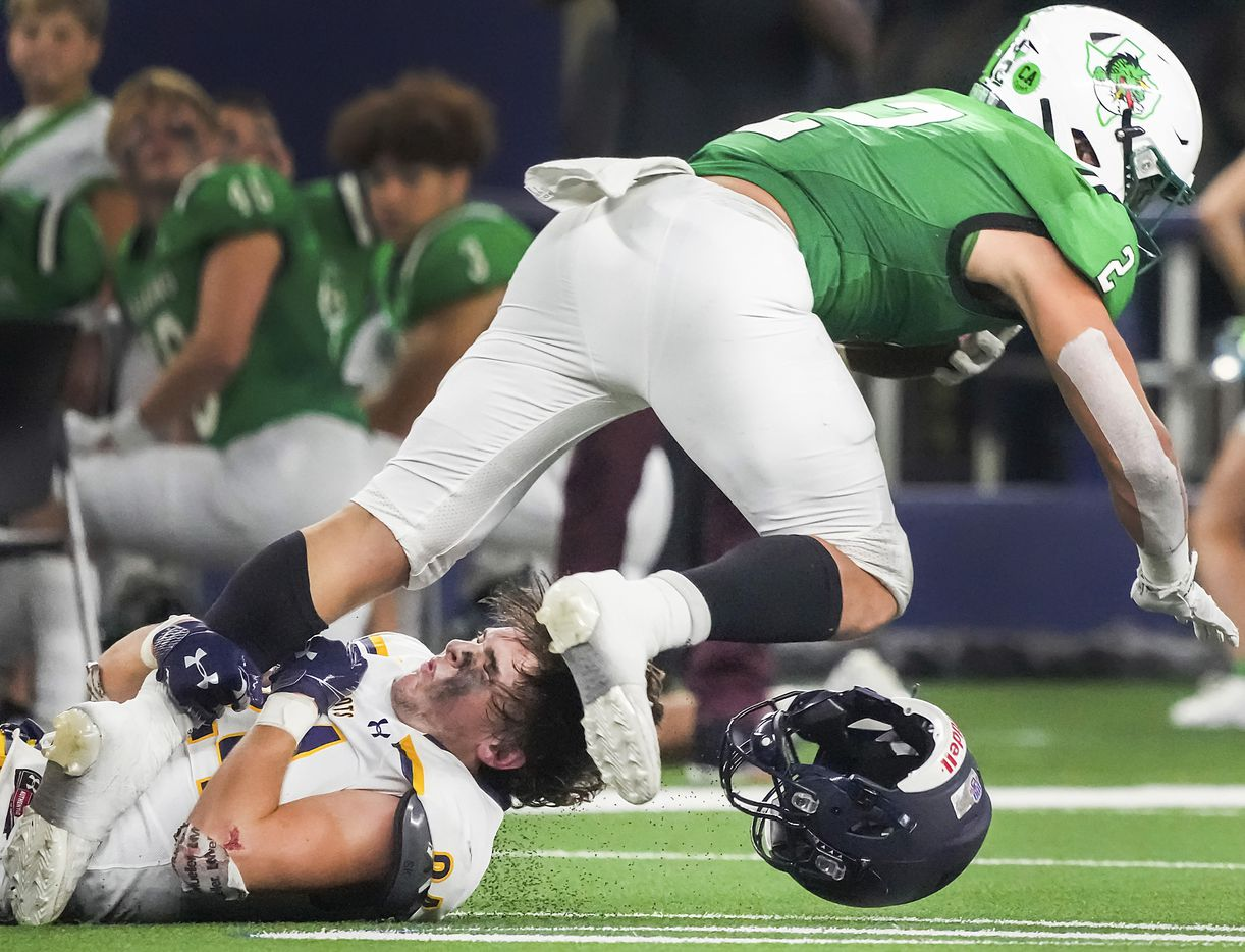 Highland Park defensive back Preston Taylor (24) has his helmet knocked off as he brings down Southlake Carroll running back Owen Allen (2) during the first half of a high school football game at AT&T Stadium on Thursday, Aug. 26, 2021, in Arlington.