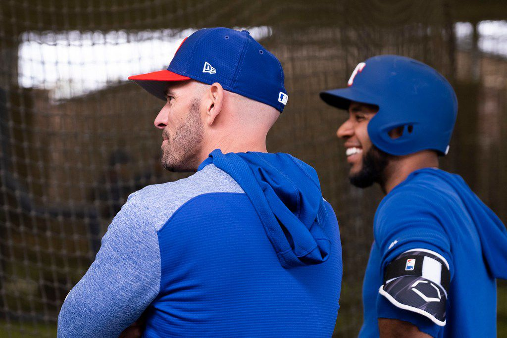 Texas Rangers manager Chris Woodward and shortstop Elvis Andrus watch batting practice during a spring training workout at the team's training facility on Thursday, Feb. 21, 2019, in Surprise, Ariz.. (Smiley N. Pool/The Dallas Morning News)
