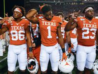 Texas Longhorns wide receiver Jordan Pouncey (86), wide receiver John Burt (1) and linebacker Jeffrey McCulloch (23) participate in The Eyes of Texas following their loss to LSU on Saturday, Sept. 7, 2019 at Darrell Royal Memorial Stadium in Austin, Texas.