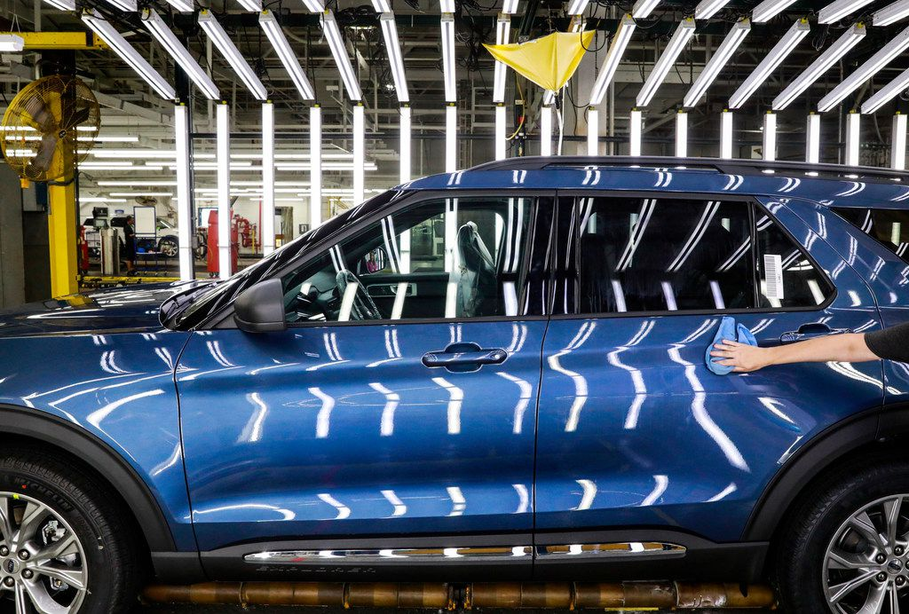 In this June 24, 2019, file photo a Ford employee works on a Ford Explorer line at Ford's Chicago Assembly Plant.