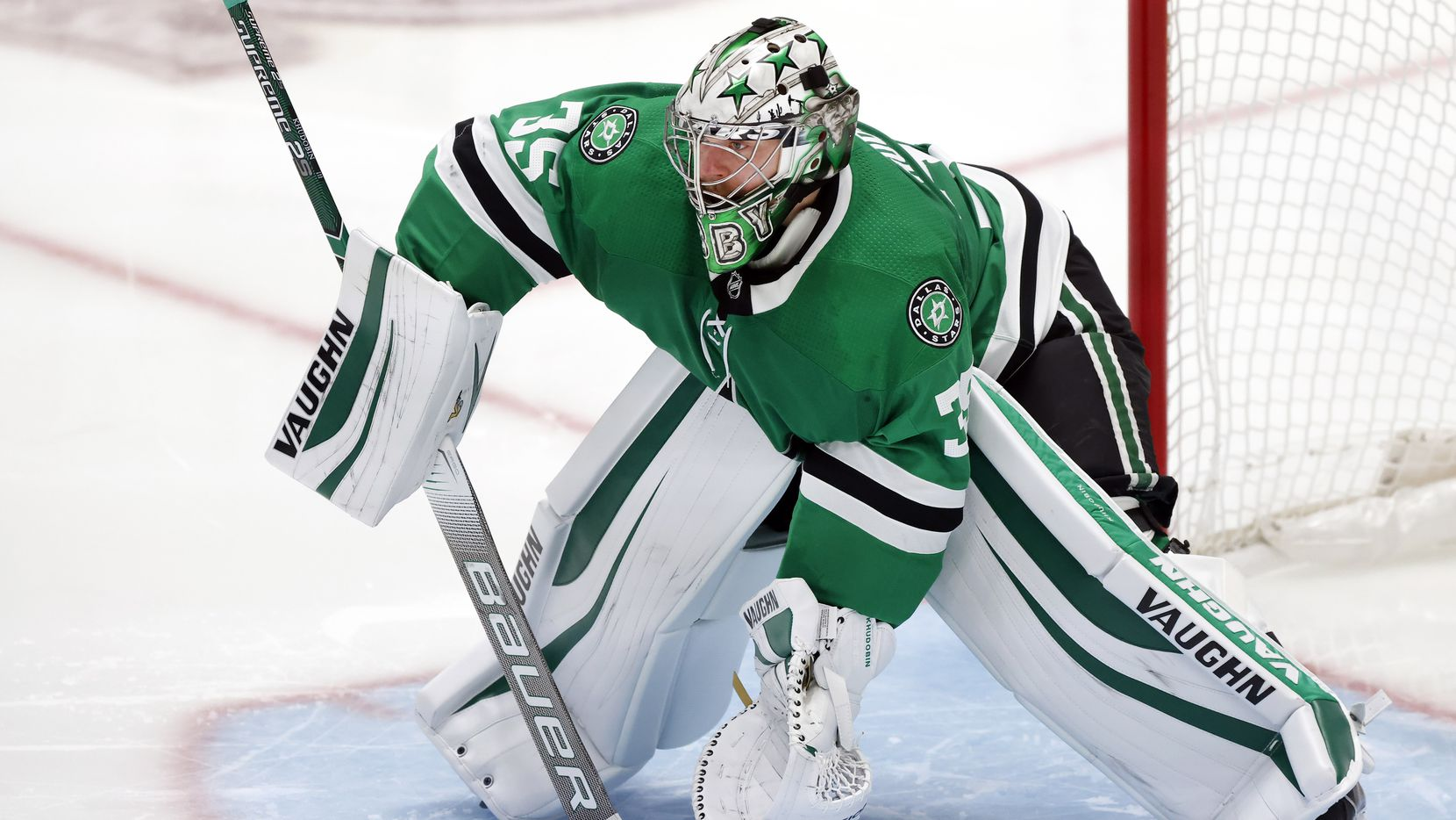 Dallas Stars goaltender Anton Khudobin (35) deflects a loosely shot puck by the Columbus Blue Jackets in the third period at the American Airlines Center in Dallas, Thursday, March 4, 2021. The Stars fell to the Blue Jackets, 3-2.