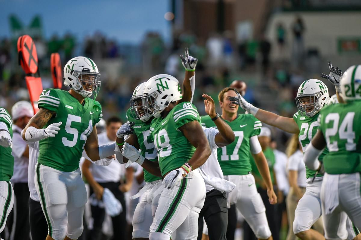 Players celebrate after North Texas linebacker Jamie King (48) recovered a fumble during the second quarter of the Mean Green's win over UTSA on Saturday. UNT will host Houston on Saturday.