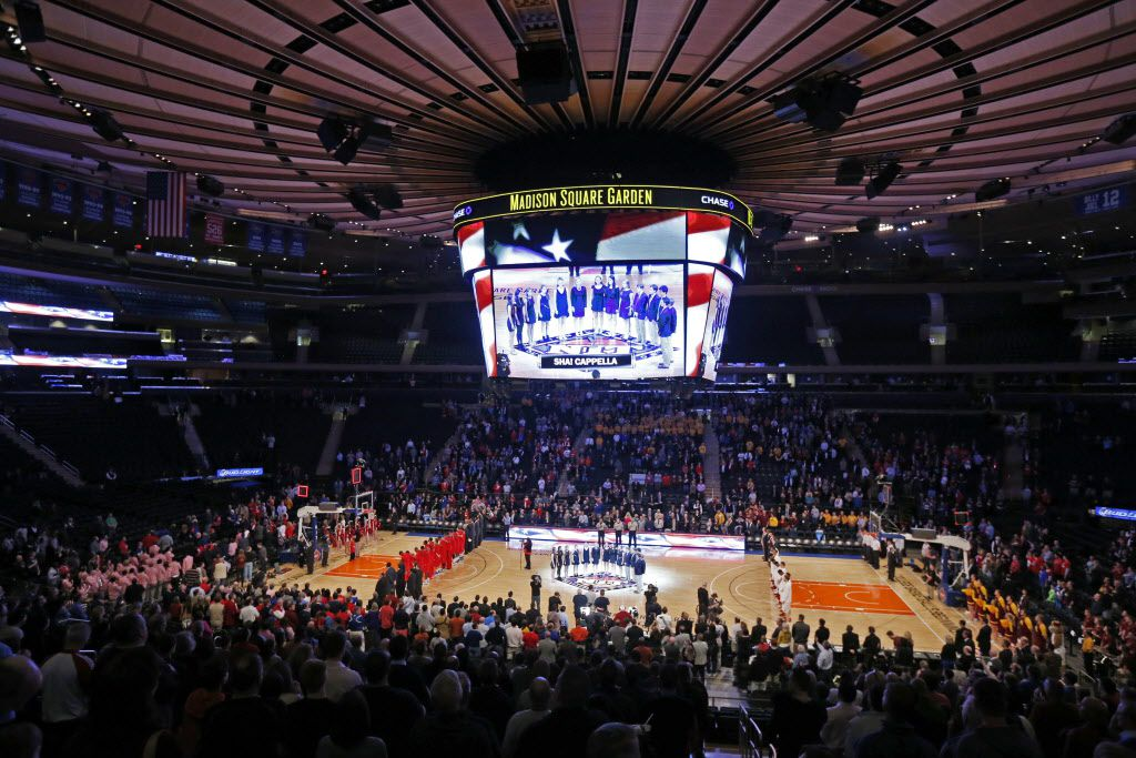 SMU and Minnesota line up for The National Anthem during the Championship game of the NIT tournament at Madison Square Garden in New York City, on April 3, 2014.
