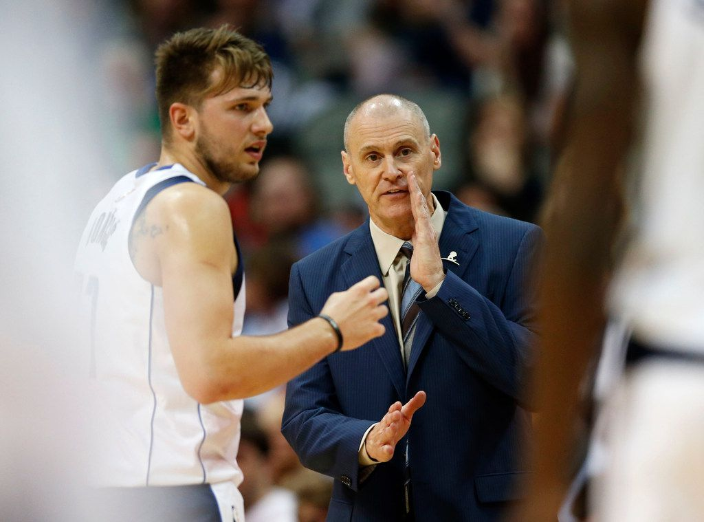 Dallas Mavericks head coach Rick Carlisle talks with Dallas Mavericks guard Luka Doncic (77) during the first half of a preseason game against the Charlotte Hornets at American Airlines Center in Dallas on Friday, October 12, 2018. (Vernon Bryant/The Dallas Morning News)