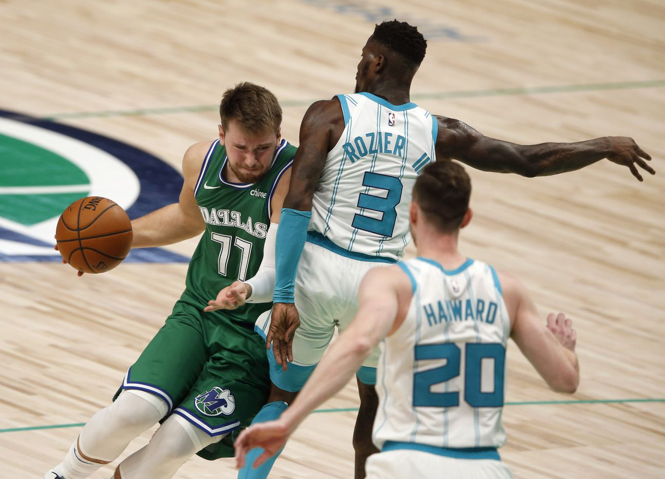 Dallas Mavericks guard Luka Doncic (77) attempts to get around Charlotte Hornets guard Terry Rozier (3) during the third quarter of play in the home opener at American Airlines Center on Wednesday, December 30, 2020 in Dallas. (Vernon Bryant/The Dallas Morning News)