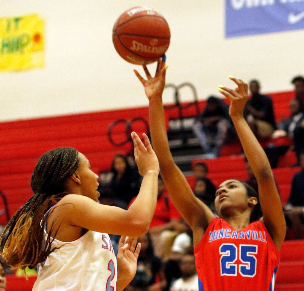 Duncanville's Deja Kelly (25) shoots over the defense of Dallas Skyline's Franchesca Jennings (24) during first half action. The two teams played their girls basketball game at  Skyline High School in Dallas on January 7, 2020. (Steve Hamm/ Special Contributor)