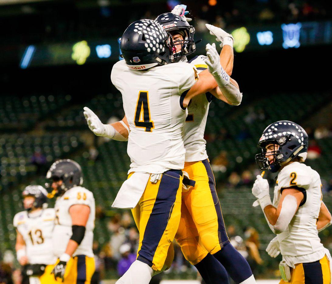 Highland Park's Crockett Corwin (4) celebrates Brooks Bond's (22) touchdown in the fourth quarter of a Class 5A Division I area-round playoff game against Frisco Independence at Globe Life Park in Arlington on Thursday, Dec. 17, 2020. Highland Park won 42-20. (Juan Figueroa/ The Dallas Morning News)
