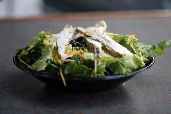 NOT THAT: Looks can be deceiving with this southwest chicken salad. The cheese, fried tortilla strips and dressing bring the salad to a grand total of 43 grams of fat and 830 calories. If you feel in the mood for the salad, take off the tortilla strips and cheese. Use salsa instead of creamy salad dressing.