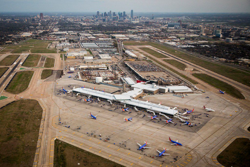 Dallas Love Field and the downtown skyline seen in a aerial view on Monday, March 6, 2017, in Dallas, Texas.