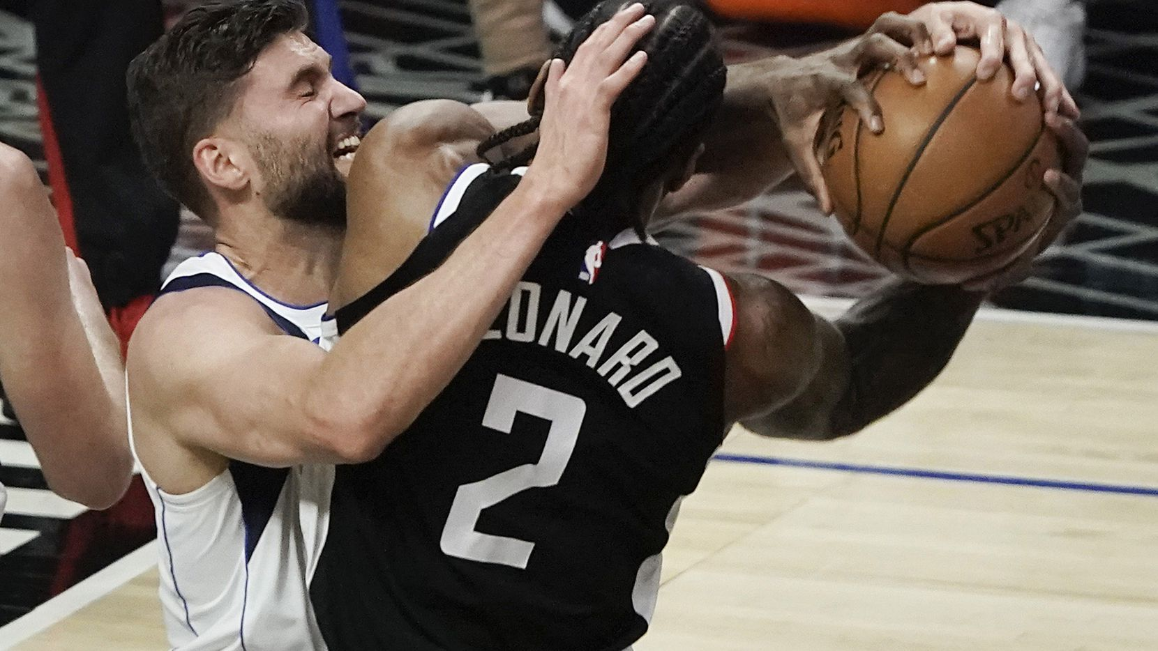 Dallas Mavericks forward Maxi Kleber (42) fights for a rebound with LA Clippers forward Kawhi Leonard (2) during the first half of an NBA playoff basketball game at Staples Center on Saturday, May 22, 2021, in Los Angeles.