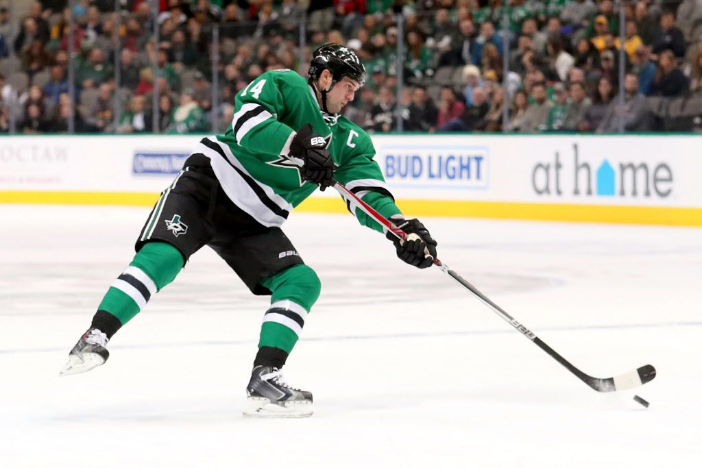 DALLAS, TX - DECEMBER 08:  Jamie Benn #14 of the Dallas Stars shoots the puck against the Nashville Predators in the first period at American Airlines Center on December 8, 2016 in Dallas, Texas.  (Photo by Tom Pennington/Getty Images)