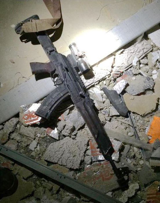 In a photo confirmed to be legitimate by law enforcement sources, a gun is shown among rubble near the body of Micah Johnson inside El Centro College in Dallas, early Friday July 8, 2016 after Johnson was killed by explosives carried by a robot.