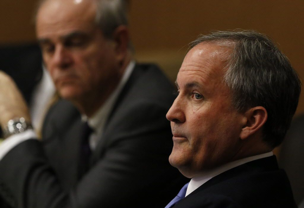 Texas Attorney General Ken Paxton, right, looks at one of the special prosecutors during a pre-trial motion hearing for his securities fraud case at the Collin County Courthouse on Tuesday, Dec. 1, 2015, in McKinney, Texas.. (Jae S. Lee/Staff Photographer)