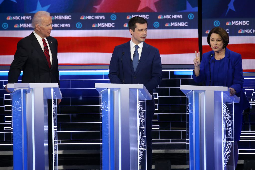 LAS VEGAS, NEVADA - FEBRUARY 19: Democratic presidential candidates former Vice President Joe Biden (L) and former South Bend, Indiana Mayor Pete Buttigieg and Sen. Amy Klobuchar (D-MN) participate in the Democratic presidential primary debate at Paris Las Vegas on February 19, 2020 in Las Vegas, Nevada. Six candidates qualified for the third Democratic presidential primary debate of 2020, which comes just days before the Nevada caucuses on February 22. (Photo by Mario Tama/Getty Images)