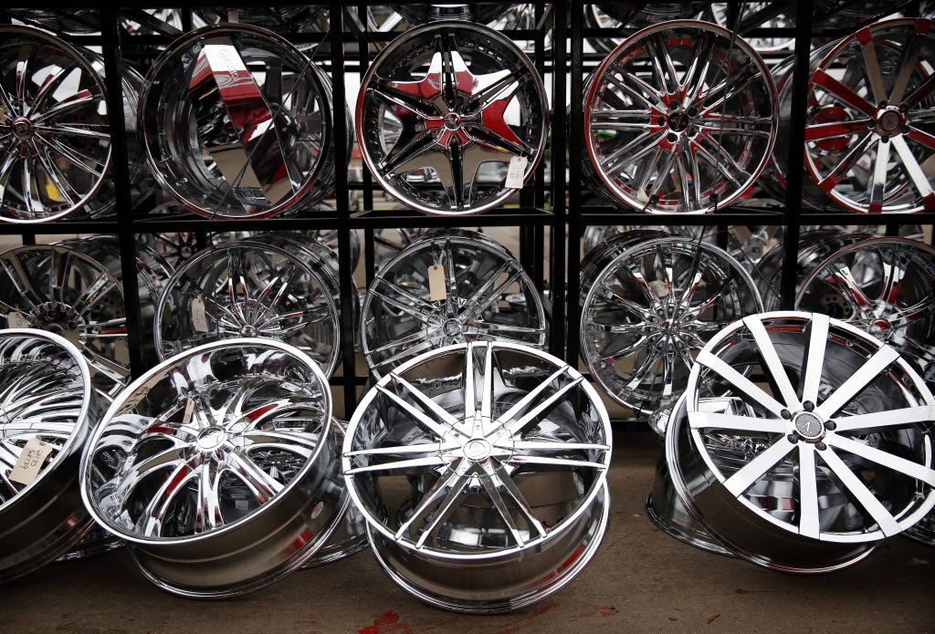 Chrome rims are on display outside of Omar's Wheels and Tires at South Buckner Blvd and Military Parkway in Pleasant Grove.