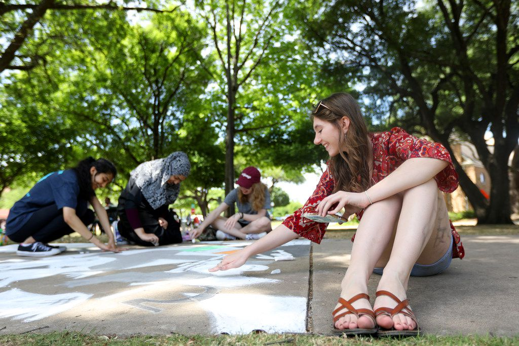 Courtney Thomas draws with chalk as part of the sidewalk chalk competition during Plano Artfest in downtown Plano on April 28, 2018.