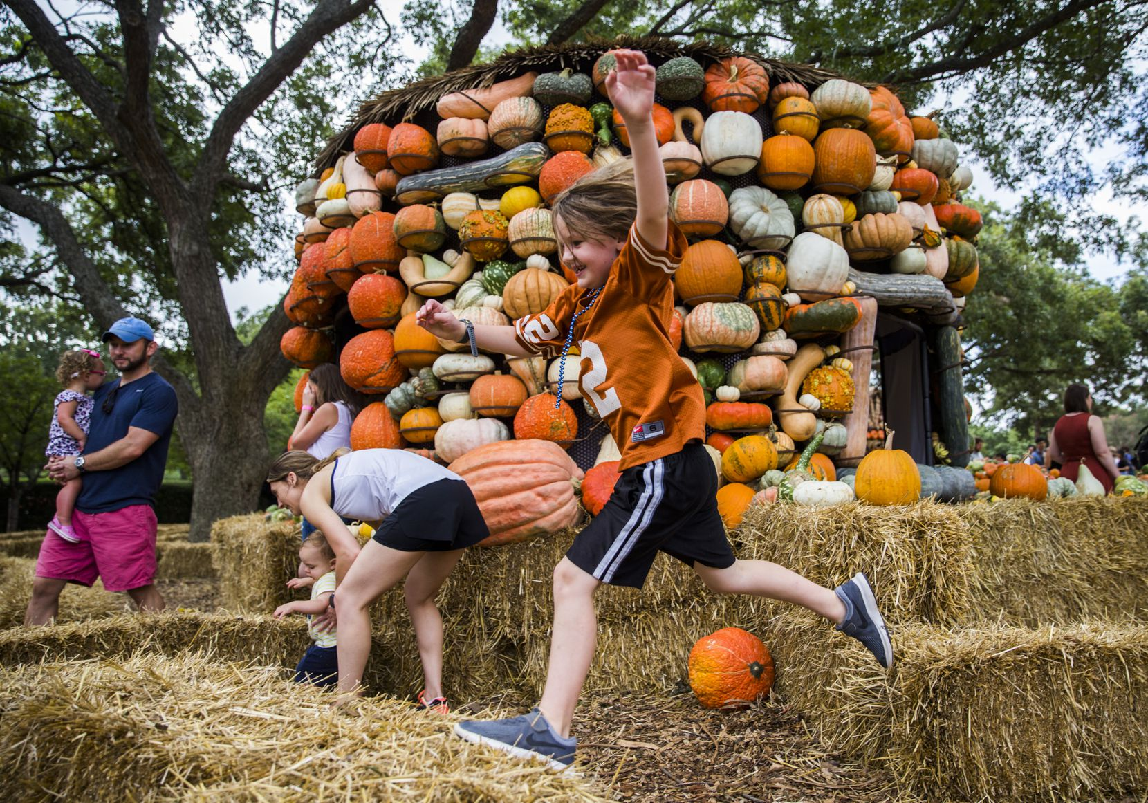 Isaac Wood jumps through the hay maze in the pumpkin village at the Dallas Arboretum's Autumn at the Arboretum in 2019. The 2021 festival will be held Sept. 18-Oct. 31.