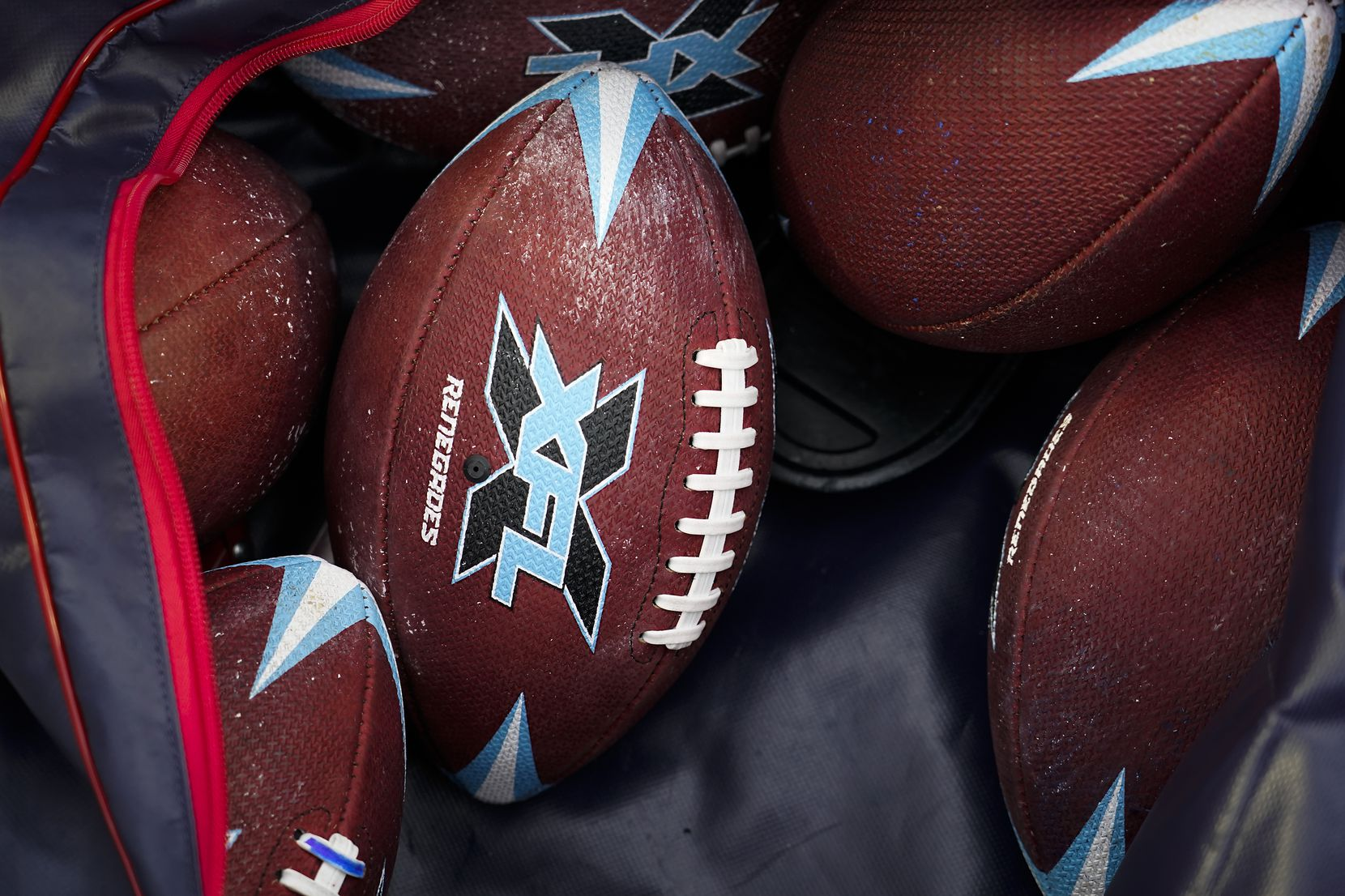 A bag of game balls is seen before an XFL football game between the Dallas Renegades and the St. Louis Battlehawks at Globe Life Park on Sunday, Feb. 9, 2020, in Arlington.