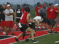 Argyle head coach Todd Rodgers, far right, directs players through a passing drill. Argyle's first day of football practice began at 6 a.m. at their new high school campus on Canyon Falls Drive in Argyle on August 2, 2021.