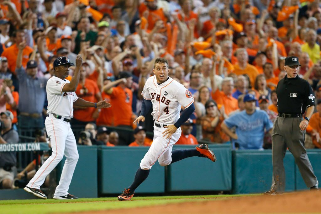 HOUSTON, TX - OCTOBER 12:  George Springer #4 of the Houston Astros rounds the bases to score the go ahead run on an RBI double in the fifth inning against the Kansas City Royals during game four of the American League Divison Series at Minute Maid Park on October 12, 2015 in Houston, Texas.  (Photo by Bob Levey/Getty Images)