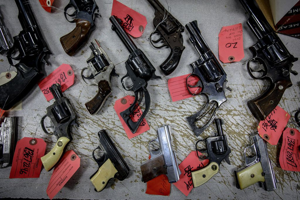 A new study finds that when domestic violence offenders must relinquish their guns instead of being barred from owning firearms, the risk that they will kill their partners goes down. (Brian Cassella/TNS)