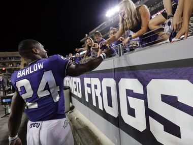 TCU running back Darwin Barlow (24) gives away his gloves to a fan after a win over Arkansas-Pine Bluff at Amon G. Carter Stadium in Fort Worth on Saturday, Aug. 31, 2019.