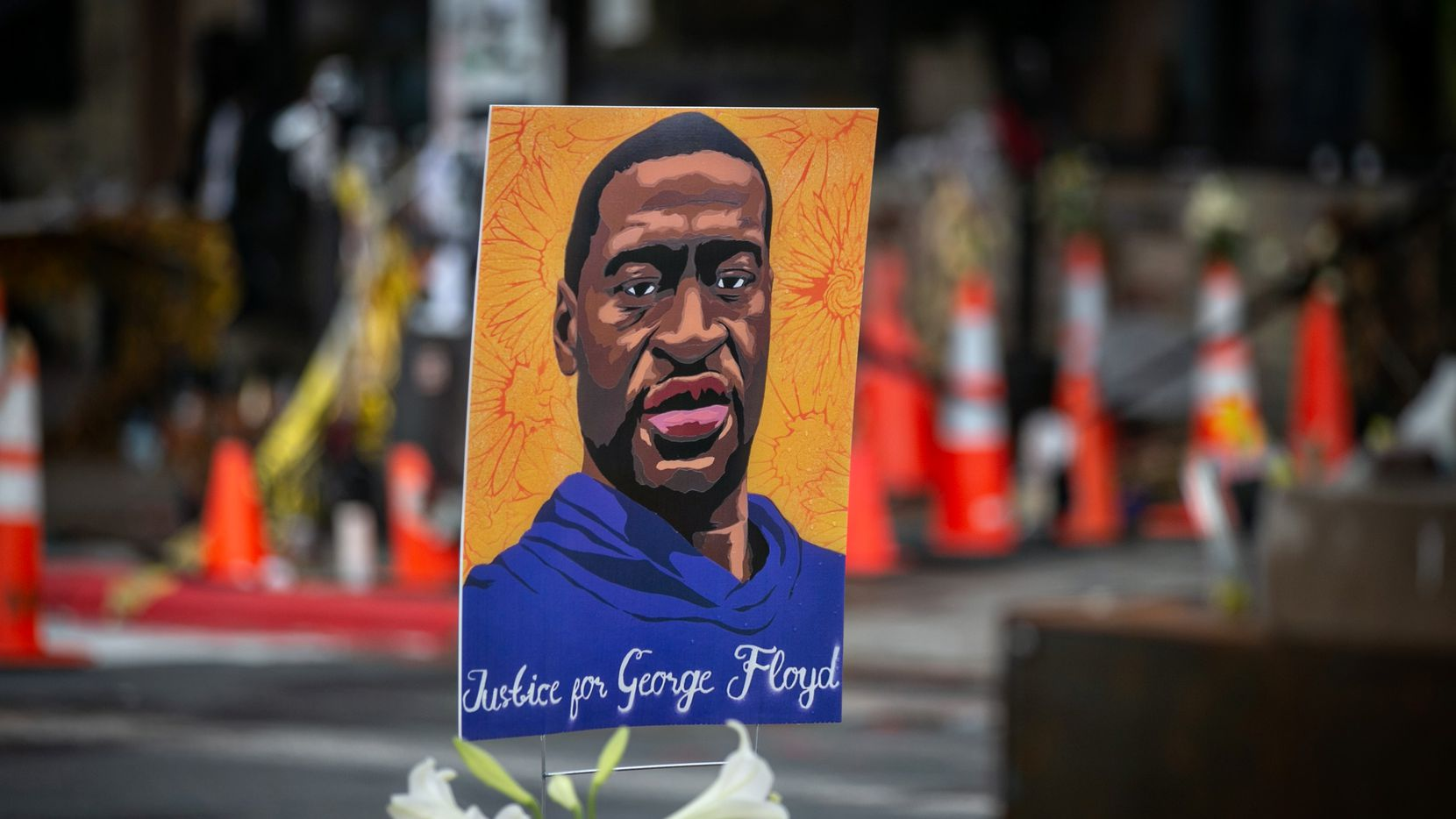Images of George Floyd have surrounded the Cup Foods store in Minneapolis outside of which he died under an officer's knee last year.