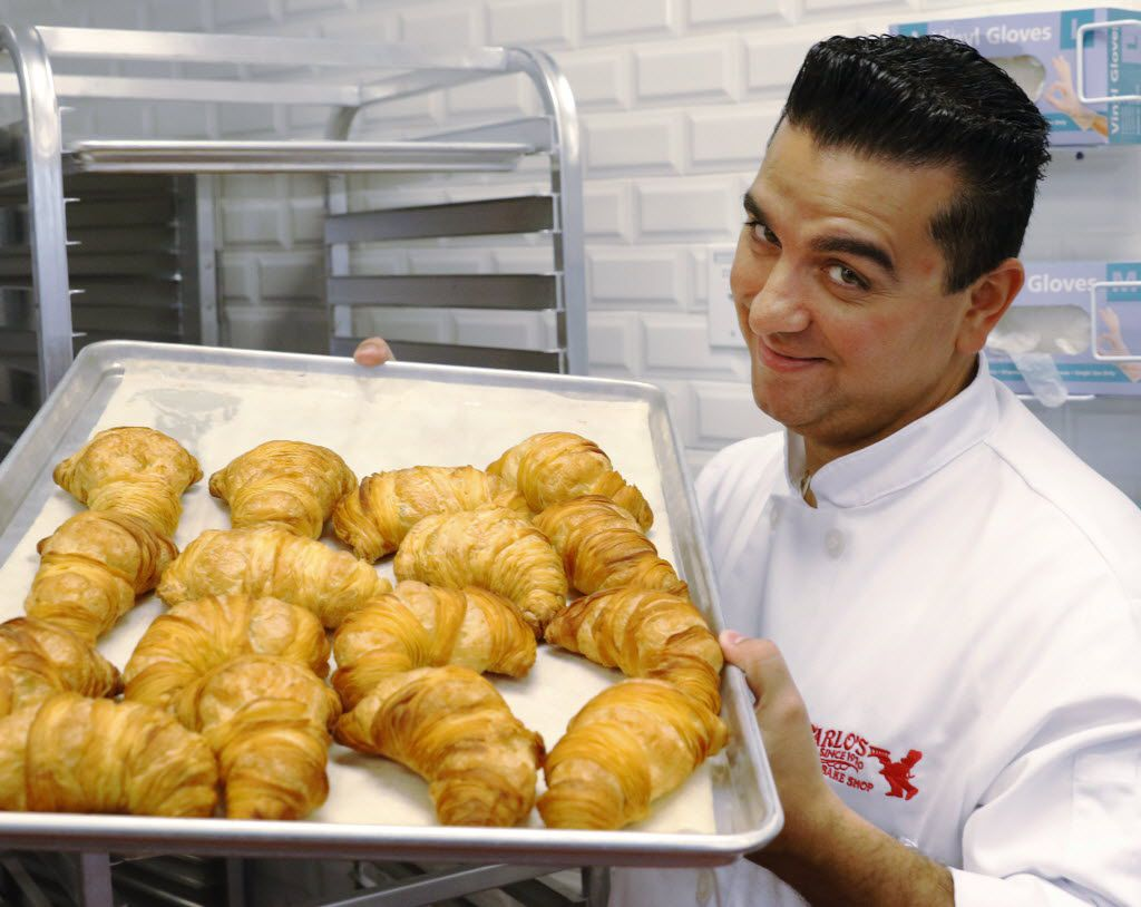 Cake Boss, Buddy Valastro holds fresh baked lobster tails at Carlo's Bakery before the opening on March 19, 2016.