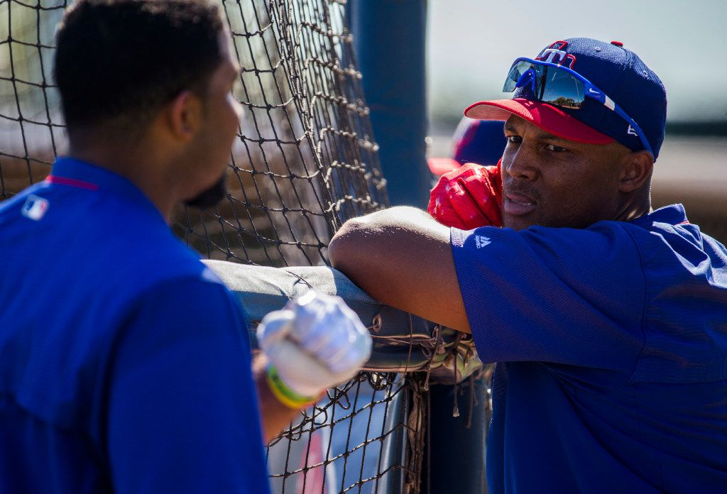 Texas Rangers shortstop Elvis Andrus (1, left) talks with third baseman Adrian Beltre (29) during a workout at the team's spring training facility on Tuesday, March 7, 2017 in Surprise, Arizona. (Ashley Landis/The Dallas Morning News)