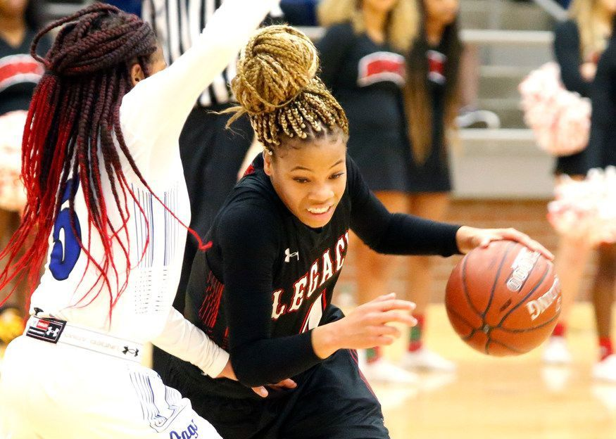 Mansfield Legacy point guard Harmoni Turner (4) drives past Mansfield Summit's Lindsey Claude during a game on Dec. 4, 2018. (Stewart F. House/Special Contributor)(Stewart F. House / Special Contributor)