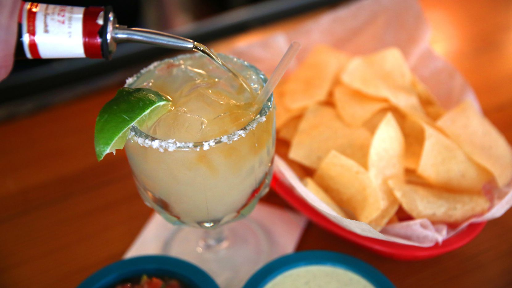 Every meal at Chuy's starts with chips and salsa. Margaritas are optional — but very popular.