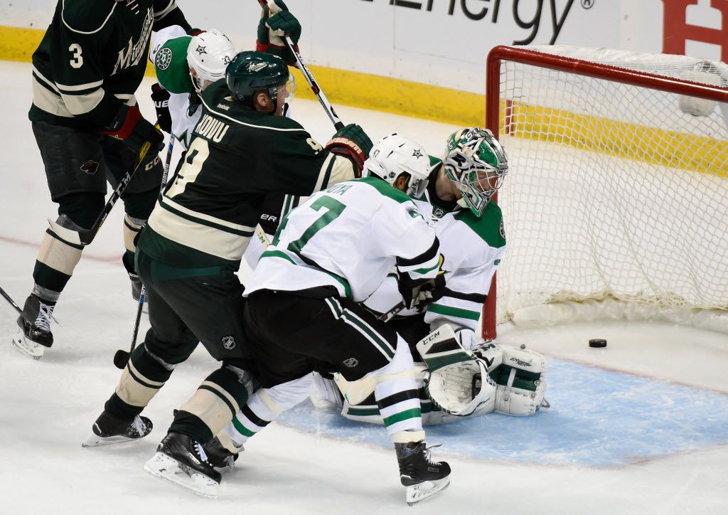 ST PAUL, MN - APRIL 18: Mikko Koivu #9 of the Minnesota Wild gets the puck past goalie Kari Lehtonen #32 to score a goal as Alex Goligoski #33 and Johnny Oduya #47 of the Dallas Stars look on in the third period of Game Three of the Western Conference Quarterfinals during the 2016 NHL Stanley Cup Playoffs on April 18, 2016 at Xcel Energy Center in St Paul, Minnesota. The Wild defeated the Stars 5-3. (Photo by Hannah Foslien/Getty Images)