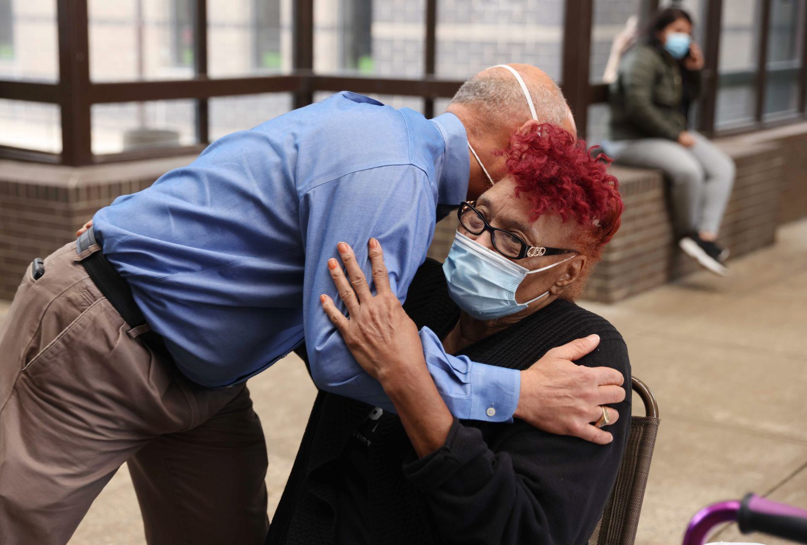 Dallas County District Attorney John Creuzot, left, hugs Lucille Spencer, mother of Ben Spencer, outside the Dallas County jail in Dallas as she waited for her son to be released on Friday, March 12, 2021.