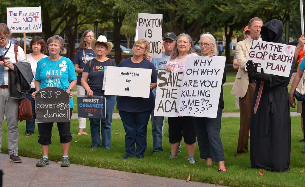 Supporters of the Affordable Care Act protest during a rally at Burnett Park in Fort Worth, Texas, Wednesday, Sept. 5, 2018. Democratic nominee for Texas Attorney General Justin Nelson hosted the Fort Worth Rally for Preexisting Coverage Protection.